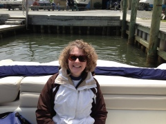 Myrna is bundled up for a cold, wet day on the Boat!